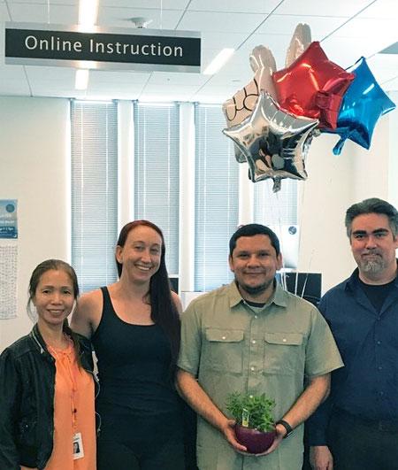 David Vasquez, Instructional Associate Online Instruction and co-workers