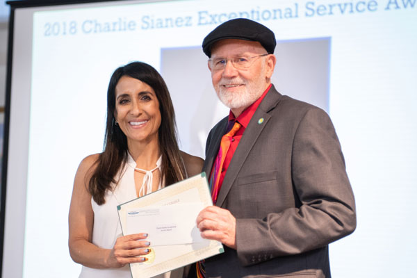Wes with The Charlie Sianez Service award 2018, Denise
